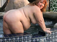 Chubby redhead exposed her fat belly and played with her big melons