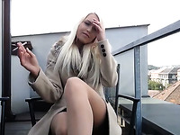 Blond haired beauty in nylon stockings was tickling her own pussy