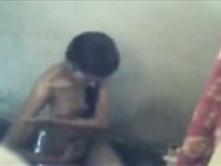Hidden cam caught washing in the shower dark haired Desi chick