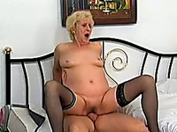 Blonde granny blows dick on the bed and rides on it