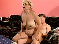 Blonde busty woman rides on a dick of a young white man