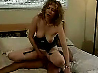 Pale skin blonde mature woman in black lingerie blows and rides dick on the bed