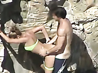 Sunbathing bikini chick got nailed doggy style outdoors on spy cam