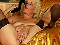 Mature blonde white woman fingers herself and teases with high heels