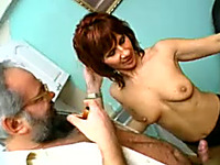 Two white sluts sucking one dick of an old man in the kitchen