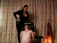 Tough mistress in rubber costume smokes and fills my mouth with ash