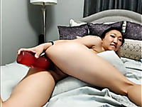 Lovely amateur flat chested Asian brunette had a huge red dildo to pet anus