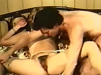 Cute blonde classic milf with hairy pussy sucks cock on the bed