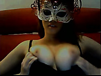 Sexy masked girl showing big boobies on webcam