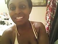 Sexy ebony girl showing big butt in the bathroom