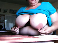 Naughty Spanish slut with huge boobs suckles her own nipples