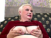 Short haired white BBW lady on the couch shows her big breasts