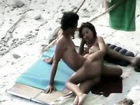 Mutual spooning pleasures of amateur slender couple right on the beach