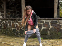 Naturally hot and pretty girl in grey pants wanna pee outdoors