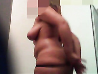 Amateur chubby MILF caught naked on hidden camera in the bathroom