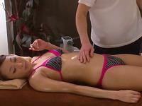 Getting my oiled body massaged while wearing a bikini