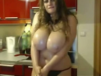 Chubby webcam model enjoys kneading her huge tits in the kitchen