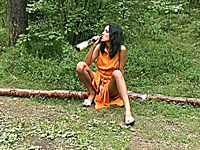 Skinny brunette sexy Russian girl smokes and pisses in the woods