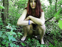 Redhead young beautiful girl in the forest pisses on cam