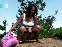 Lusty gal with nice butt does not mind pissing outdoors