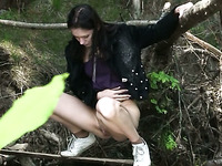 Brunette skinny Russian student girl pisses in the forest
