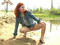 Redhead Russian skinny girl outdoors pisses by the road