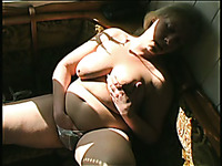 BBW blonde old woman flashes her breasts topless and pokes herself with a dildo