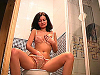 Sensual and fine brunette girl in sexy lingerie undresses and pisses in the toilet