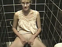 Horny blonde slut pees in the toilet room for your jerking pleasure