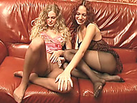 Fine brunette and redhead skinny girls on the couch pose topless