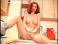 Sexy redhead Yulia is looking to get off on top of the kitchen counter