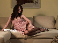 Magnificent redhead Russian teen beauty in pink dress strips on the couch