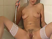 This kinky chick loves playing with the shower head when she's horny