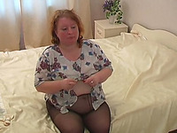 An ugly white blonde BBW mature lady on the bed undresses on cam