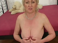 Curly haired wrinkled mature slut in sexy stuff sucks strong cock