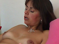 Hot mature white woman on the couch masturbating topless