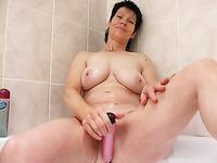 Busty short haired amateur brunette milf masturbating in the bathroom