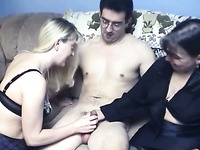 A couple of milf sluts giving double blowjob to a guy