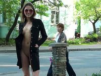 Fabulous and skinny young exhibitionist shows her goodies on the street