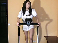 Magnificent amateur brunette white chick jogging on the treadmill