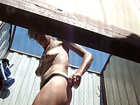 Slender and busty white woman in the cabin filmed topless on spycam