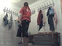 Sexy young brunette girl in the locker room undresses on hidden cam