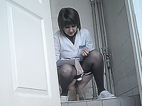 White stranger lady in black pantyhose pisses in the toilet room