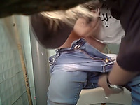 Blonde white stranger chick in blue jeans filmed in the toilet
