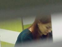 Beautiful redhead stranger girl filmed in the public restroom