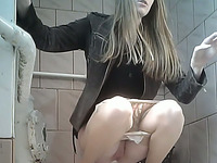 Pale skin white chick in the restroom filmed from front side