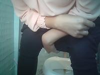Pale skin white girl in tight black pants pisses in the restroom