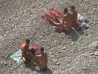 Awesome voyeur video from the nudist beach with some amateur strangers