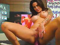 Nice tattooed MILF with sexy big rack loves big pink toy deep in her anus