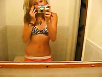 Slender pretty blonde girl flashed her small tits while stripping on webcam